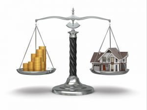 Home and money on scale