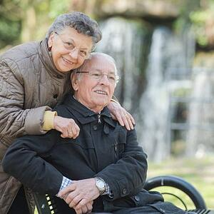 Older-couple-with-wheelchair-400x400