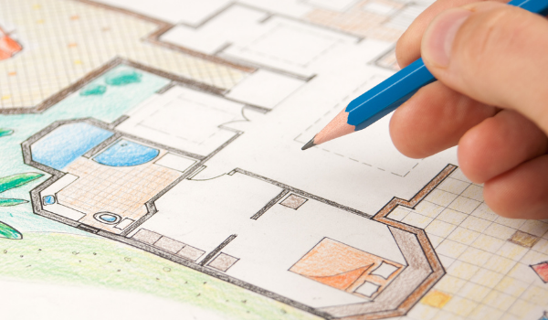 Person drawing home plans